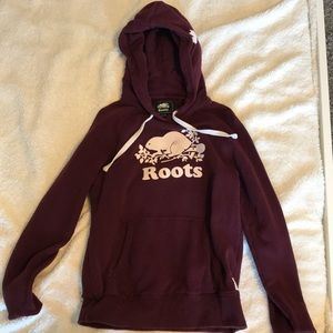 a burgundy roots hoodie in the size of xs!